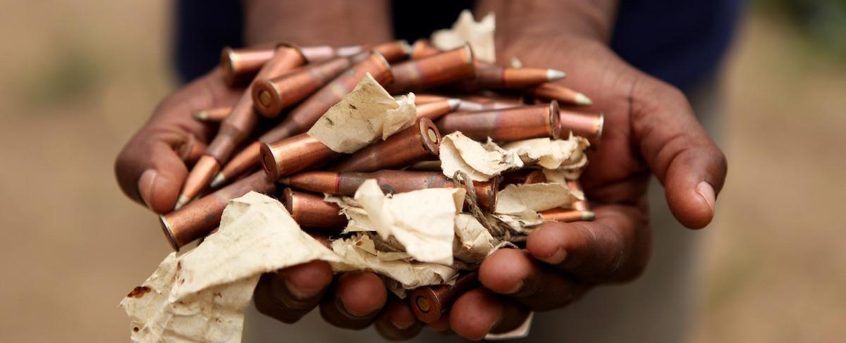 UN Photo, hands holding amunition